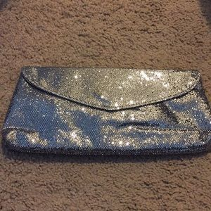 NWT silver sequin clutch.